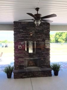 Eldorado Stone fireplace in the summer kitchen